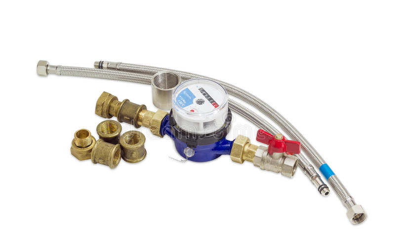 Residential water meter with some plumbing components. Residential mechanical water meter for consumption measuring of a cold water with some plumbing components stock image