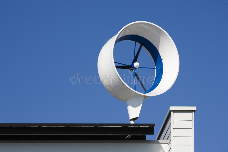 Residential wind turbine. On a house in Almere, the Netherlands stock image