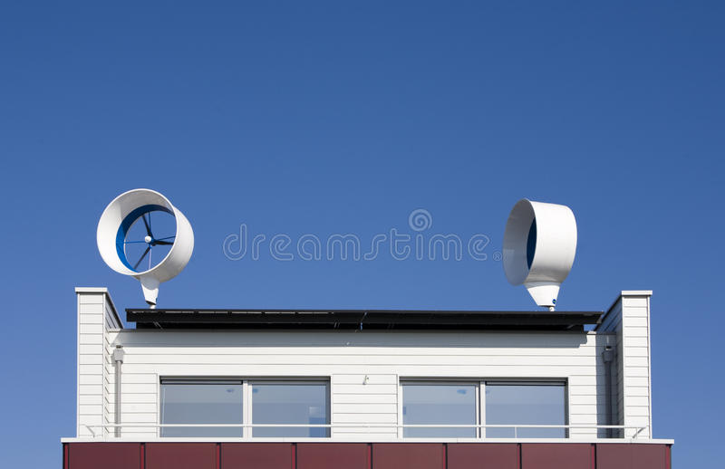 Residential wind turbines. On a house in Almere, the Netherlands royalty free stock photos