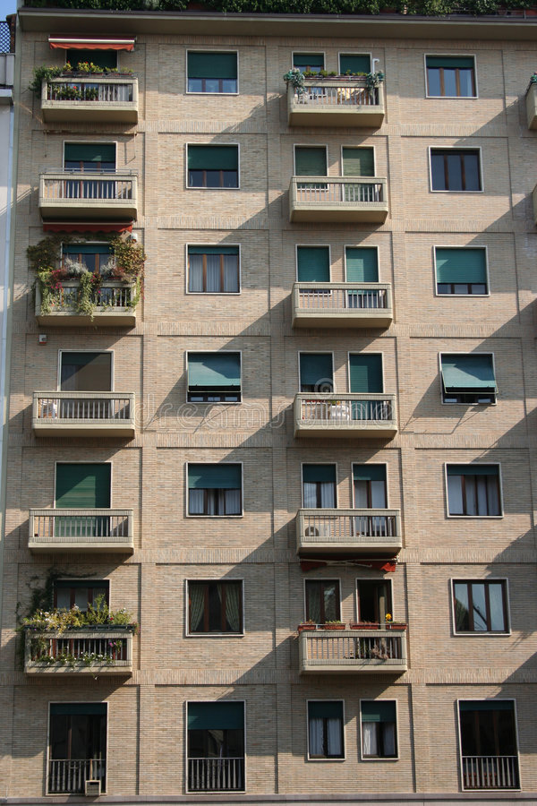 Residential windows background. Residential appartment windows background with balconies royalty free stock photo