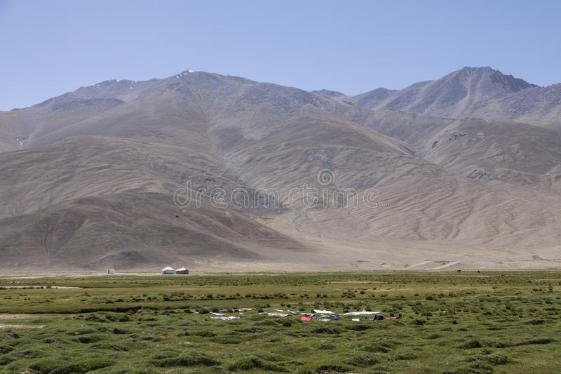 Residents of Bulunkul in Tajikistan have designed the washes to dry on the grass. Asia stock photos
