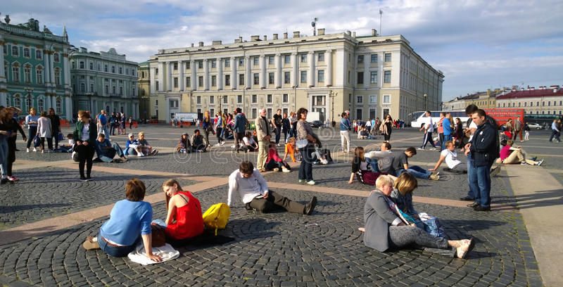 Residents and guests of St. Petersburg have a rest at the Palace square in the city centre on a Sunny summer day royalty free stock photo