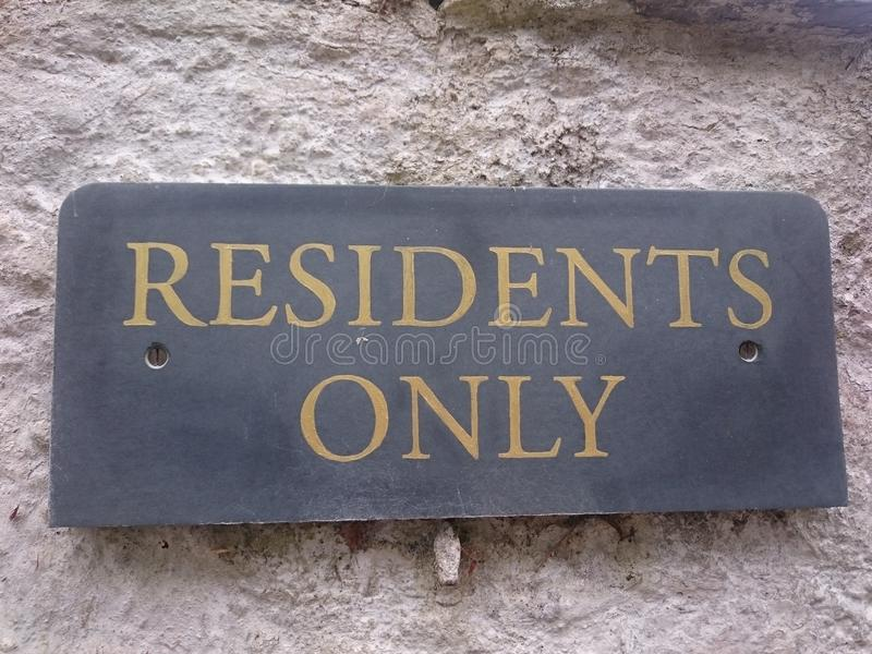 Residents Only Sign. On the concrete wall royalty free stock image