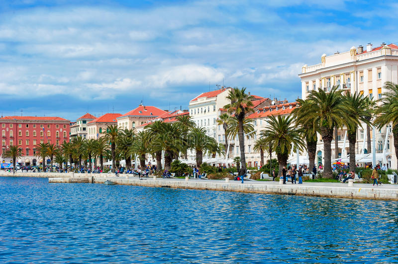 Residents and tourists walking along the shore in Split. Residents and tourists walking along the shore in the largest city on the coast in Croatia, Split with royalty free stock photography