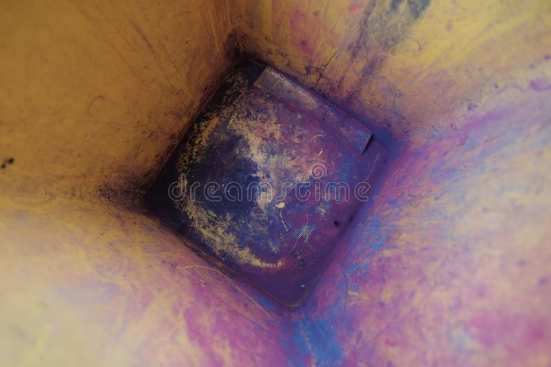Residual colored toner the garbage bin. Residual colored toner in the garbage bin royalty free stock images