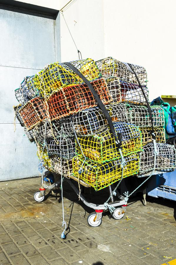 Resign Fishing Cages. Fishing cages outside the docks in a winter day in Estepona Spain with colors stock photography