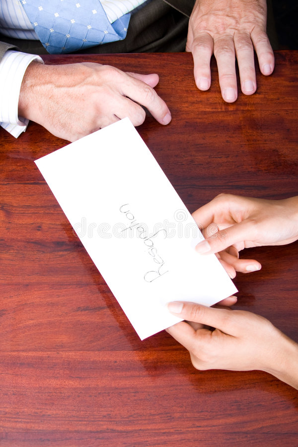 A business woman handing in a letter