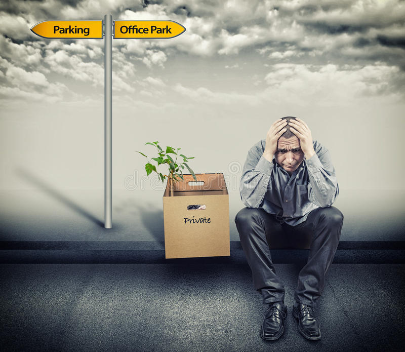 Resignation. Man was made redundant and leaves stock photo