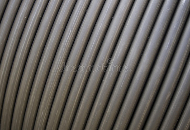 Resistant Connection Cables. Detail of a coil of wire data connection, internet stock photography
