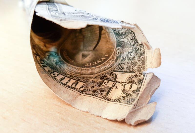 resistido usado mal uma imagem da nota de dólar imagem de stock