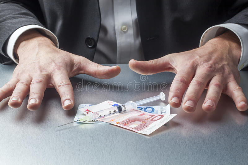 Resisting in grabbing money for medical reason royalty free stock photography