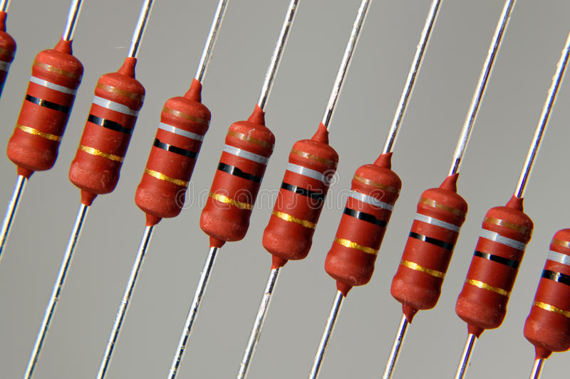 Resistors. Thru hole mounting resistors on a grey background royalty free stock images