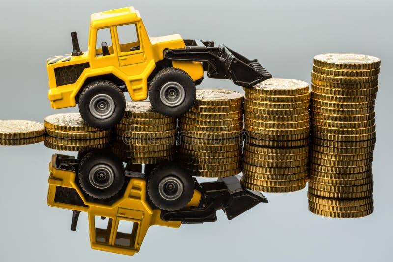 Resningen kostar i konstruktionsbranschen royaltyfri fotografi