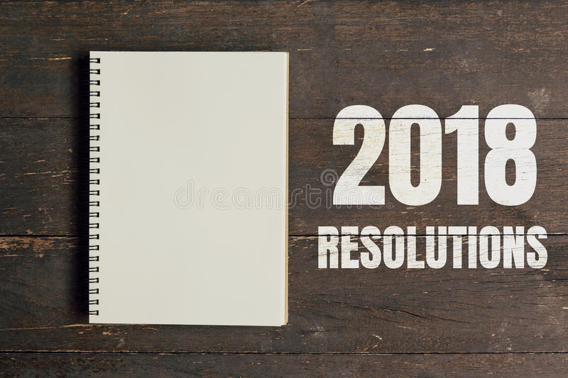 2018 Resolutions and Brown note book open on wood table background with space. royalty free stock images