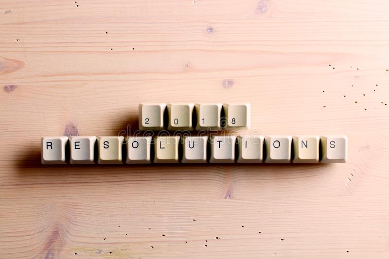 Resolutions 2018. on computer keyboard keys buttons on a wooden royalty free stock images