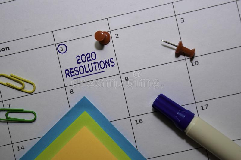2020 Resolutions text on white calendar background. Reminder or schedule concept stock photo
