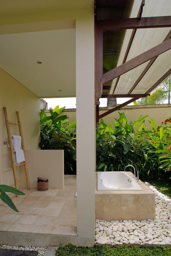 Resort bathroom shower semi outdoors. In Bali, Indonesia stock photography