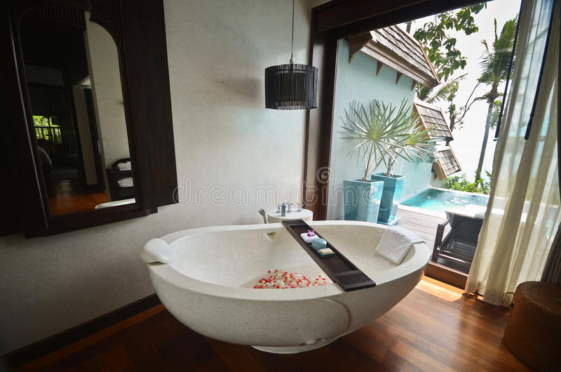 Resort bathroom spa tub. Fine appointed resort bathroom spa stock images