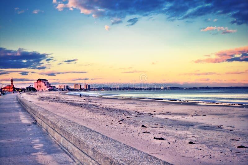Resort beach at sunset royalty free stock image