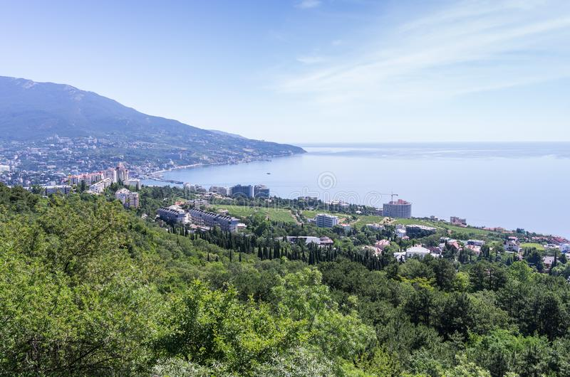 Resort city by the sea. Russia, Republic of Crimea, Yalta. 06.13.2018: View of Yalta and the Black Sea from Mount Ai-Petri royalty free stock image