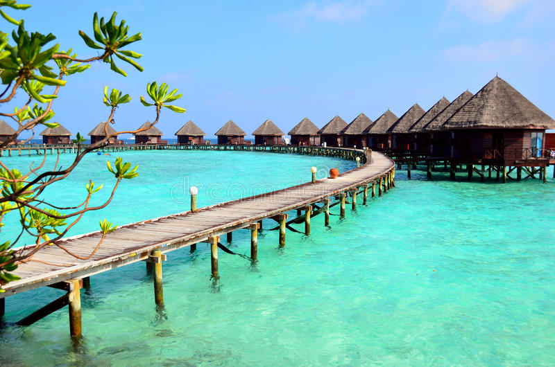 Resort in Maldives. Bungalows over water in Maldives stock images