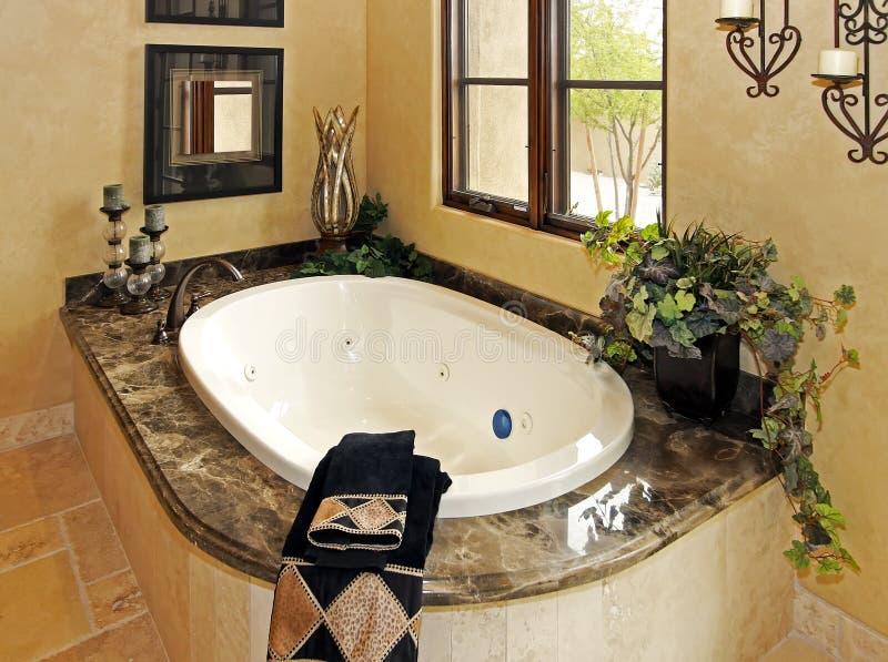 Resort mansion bathroom spa tub. Fine appointed resort mansion bathroom spa royalty free stock photos