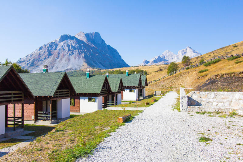 Resort mountains village . Houses huts resort hotel chalets in Komovi mountains, Montenegro royalty free stock photography