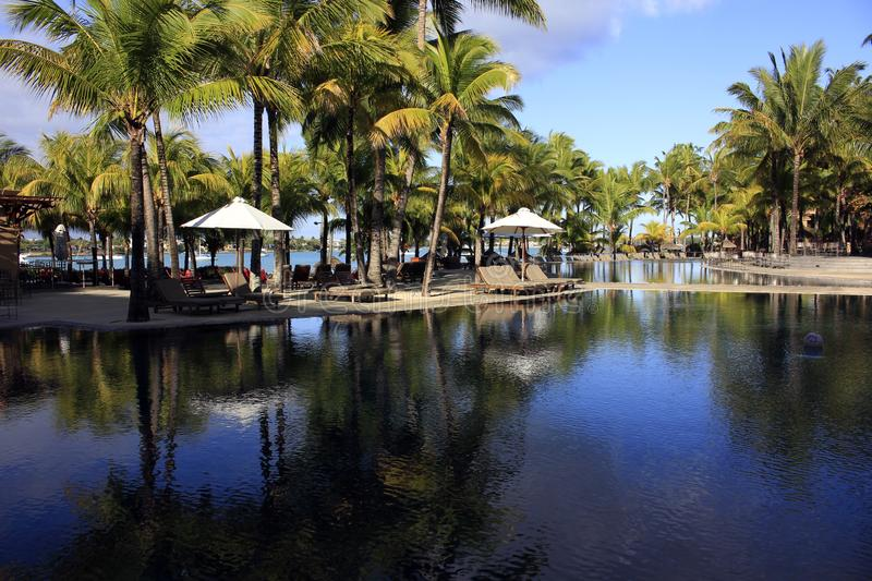 Resort Pool, Grand Baie, Mauritius. Beautiful tropical island of Mauritius, looking across a resort hotel pool towards the vibrant blue ocean of Grand Baie royalty free stock photos