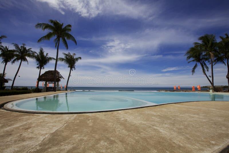 Resort Pool On Ocean Royalty Free Stock Photos