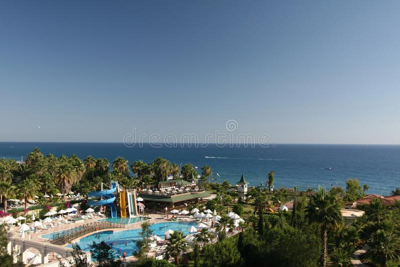 Resort pool, restaurant, beach and sea stock photos