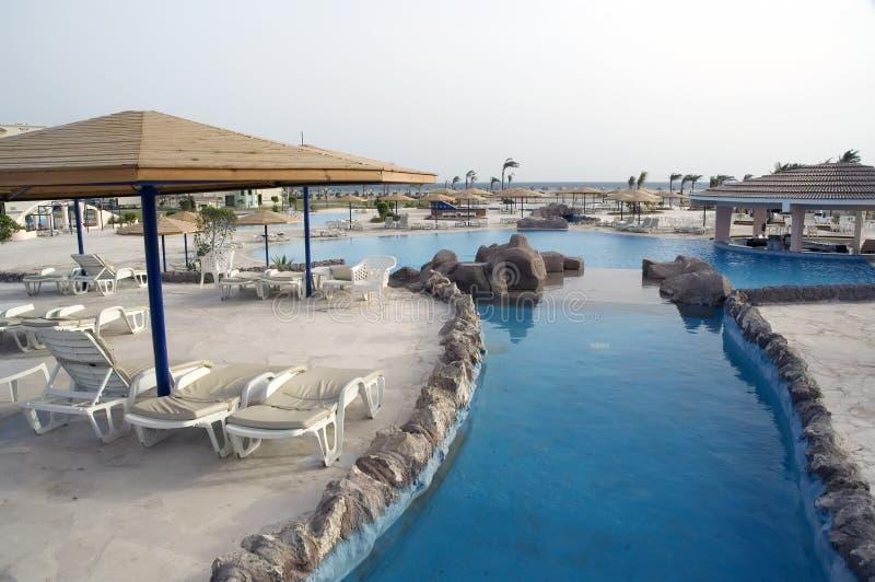 Resort pools at a sunrise royalty free stock photo