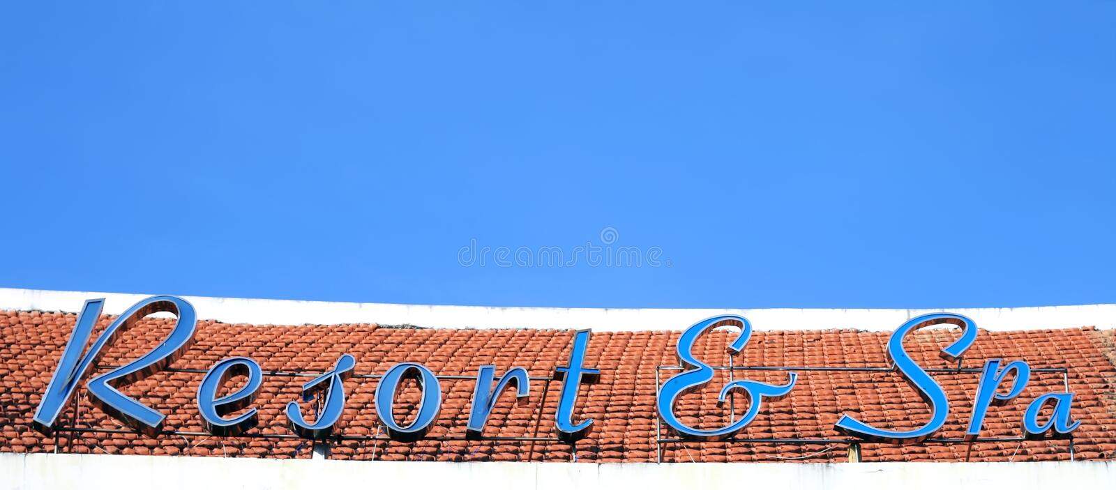 Resort & Spa. Signboard Resort & Spa on the roof of Vietnamese hotel royalty free stock images