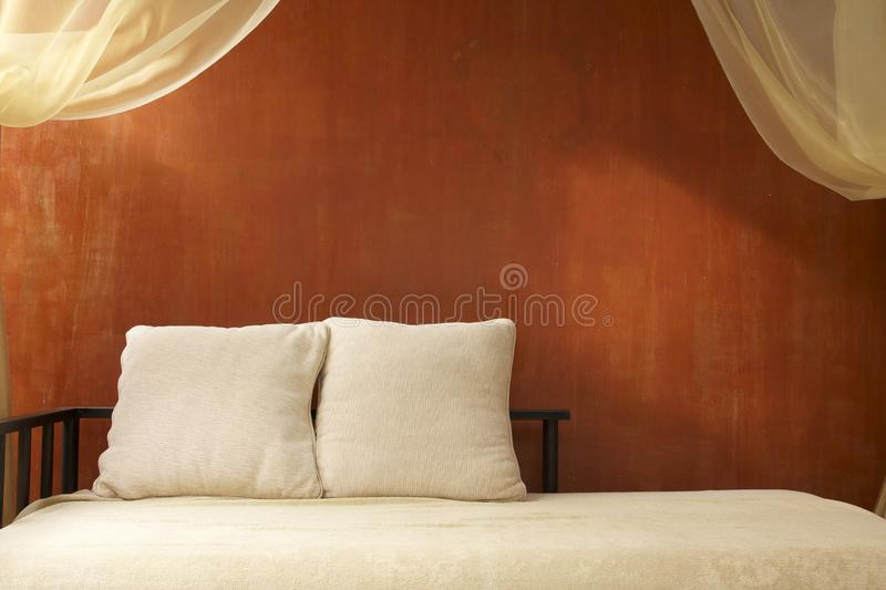 Resort and spa interior decoration. Eastern, tropical resort and spa interior decoration in earth-tone and orange color stock photos