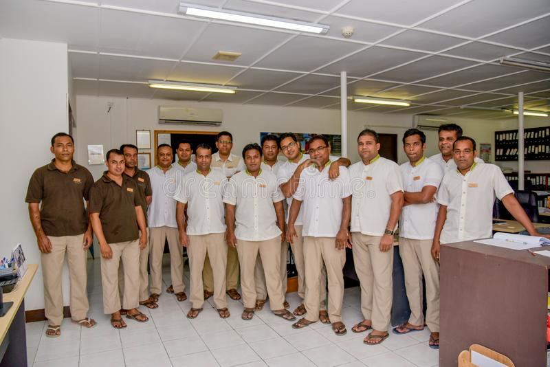 Resort staff gathered for group photo in the office stock photos