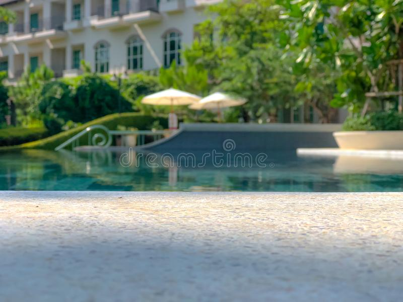 Resort style chair with umbrella and swimming pool. Outdoor of resort style chair with umbrella and swimming pool royalty free stock photo