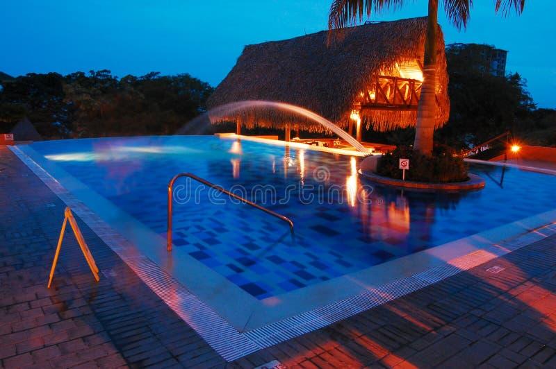Resort swimming pool shot at night stock photos