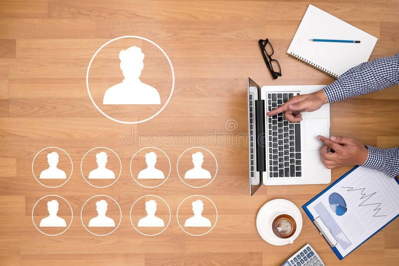 RESOURCES and Human Resources Business Profession Graphic. Businessman working at office desk and using computer and objects on the right, coffee, top view stock image