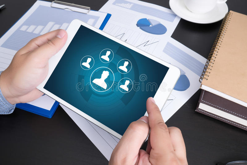 RESOURCES and Human Resources Business Profession Graphic. Modern people doing business, graphs and charts and touch-pad royalty free stock image