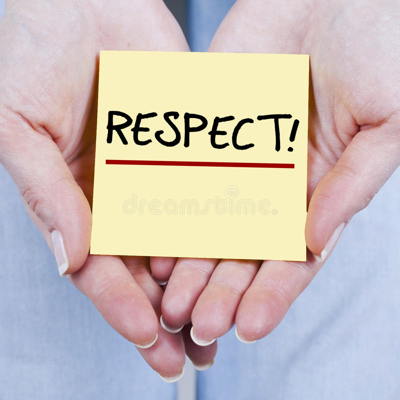 Respect. Hands holding respect note in palms stock images