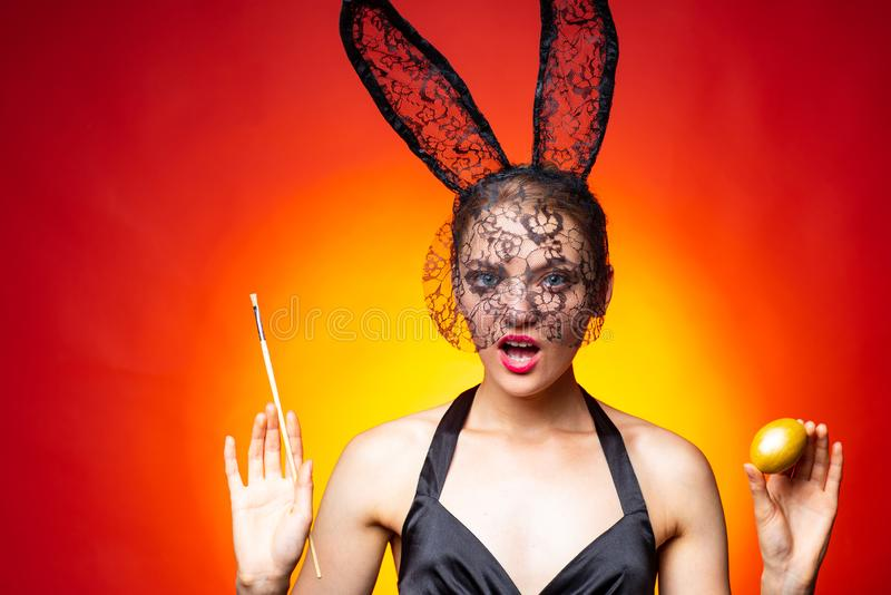 Respect traditions. Happy easter day. Bunny rabbit girl hold brush painting egg red background. Cute bunny woman royalty free stock photo