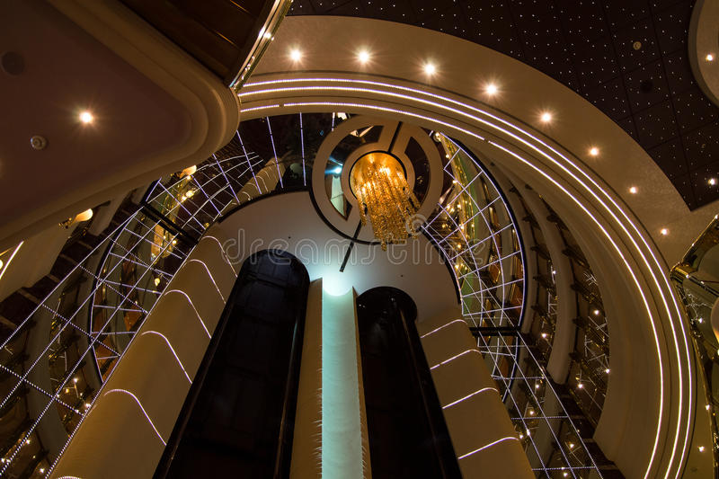 Respectable and shining interior design with elevators in luxurious cruise ship royalty free stock image