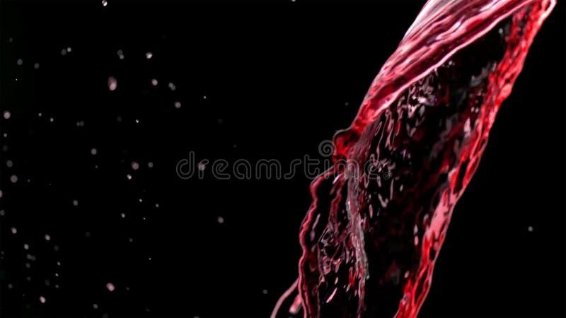 Respingo da cor isolado no fundo escuro fotografia de stock