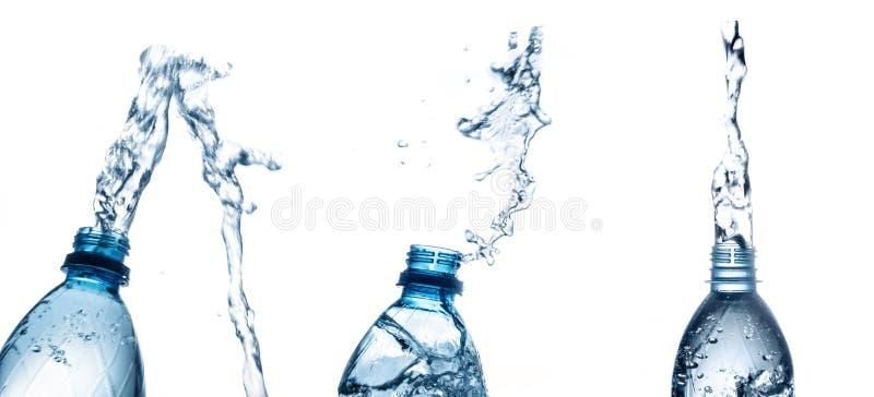 Respingo da garrafa de água isolado no branco fotos de stock royalty free