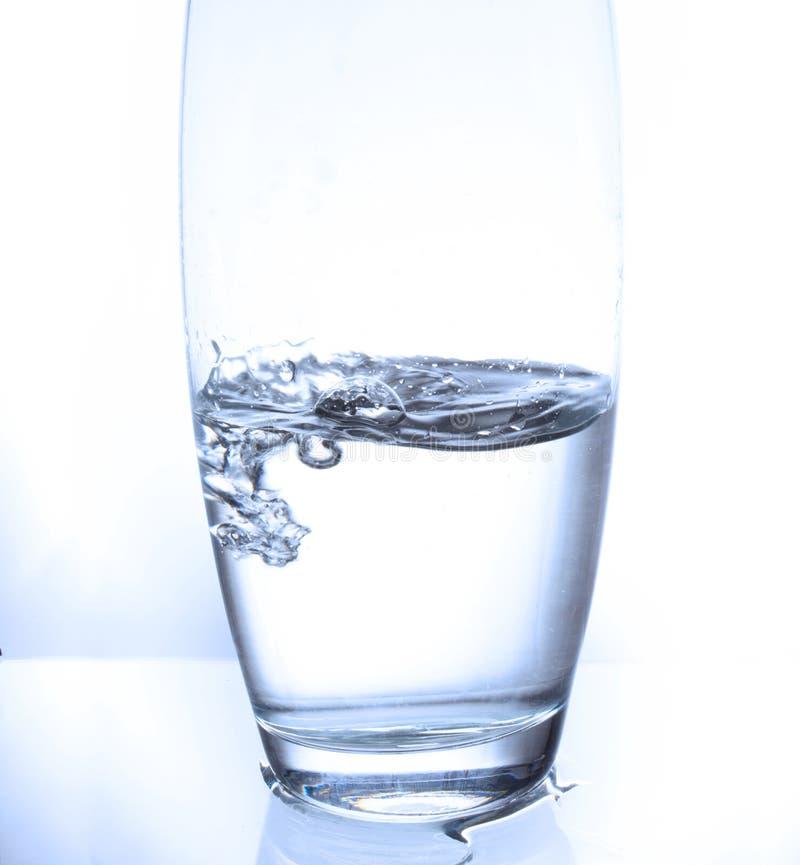 Respingo em um vidro imagens de stock