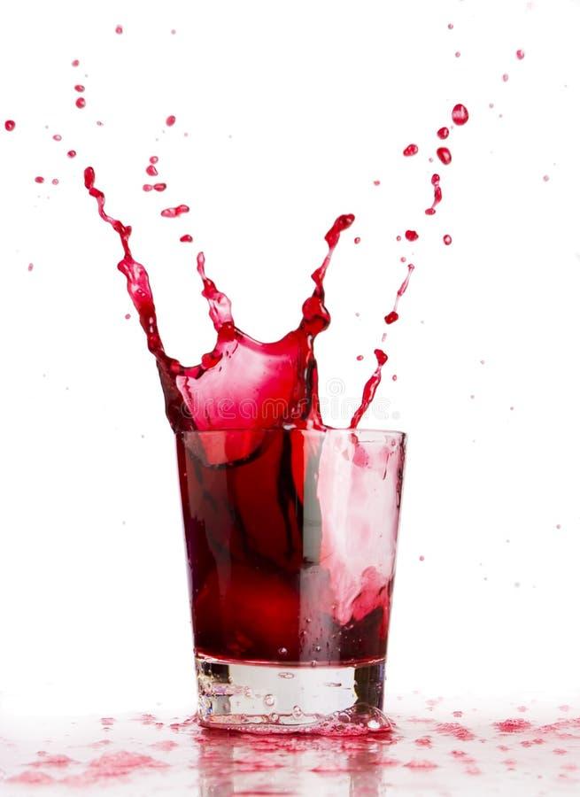 Respingo líquido vermelho imagens de stock