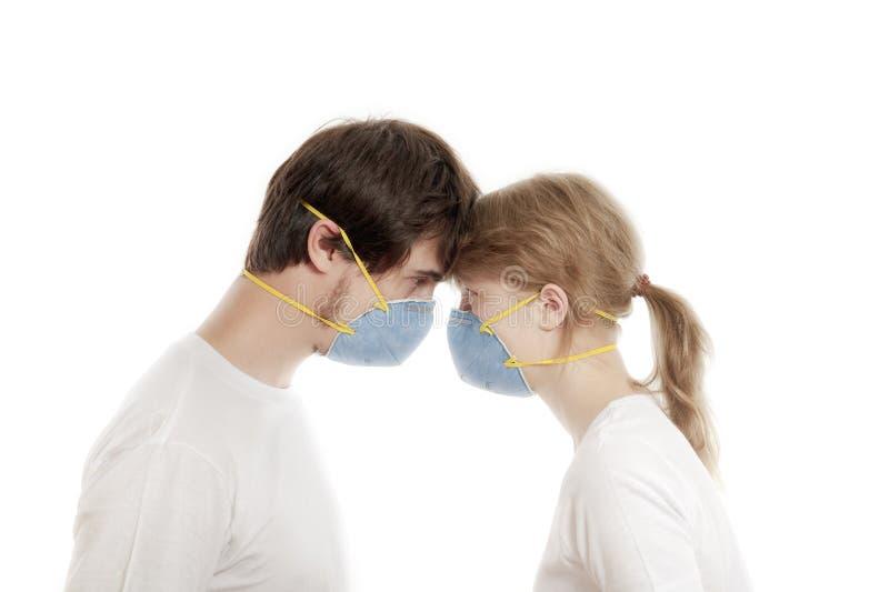 Respiradores que desgastan de los pares jovenes foto de archivo