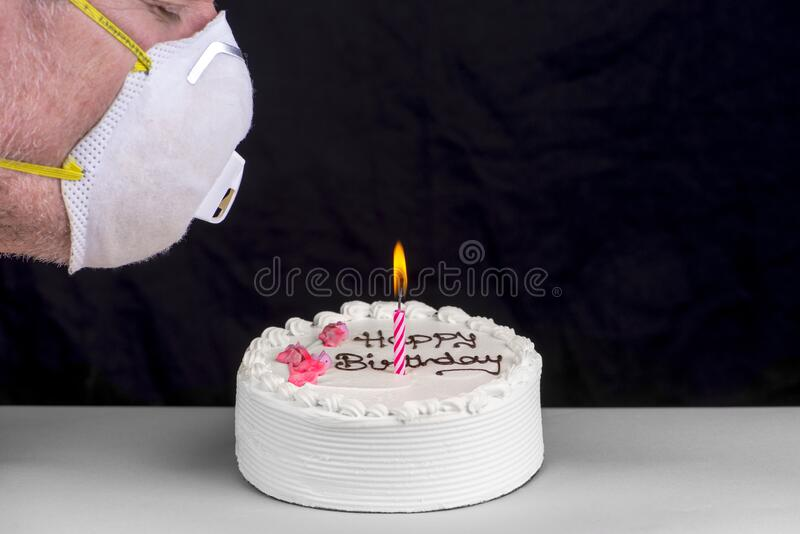 Man trying to blow out a birthday cake candle. royalty free stock photos
