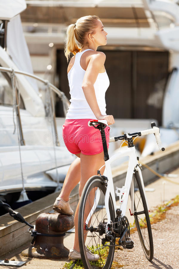 Respite. Sportive girl having respite during bicycle ride stock photo