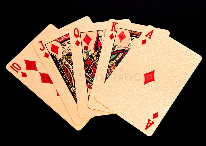 Resplendor reto real que joga a mão de pôquer dourada dos cartões nos diamantes fotografia de stock royalty free