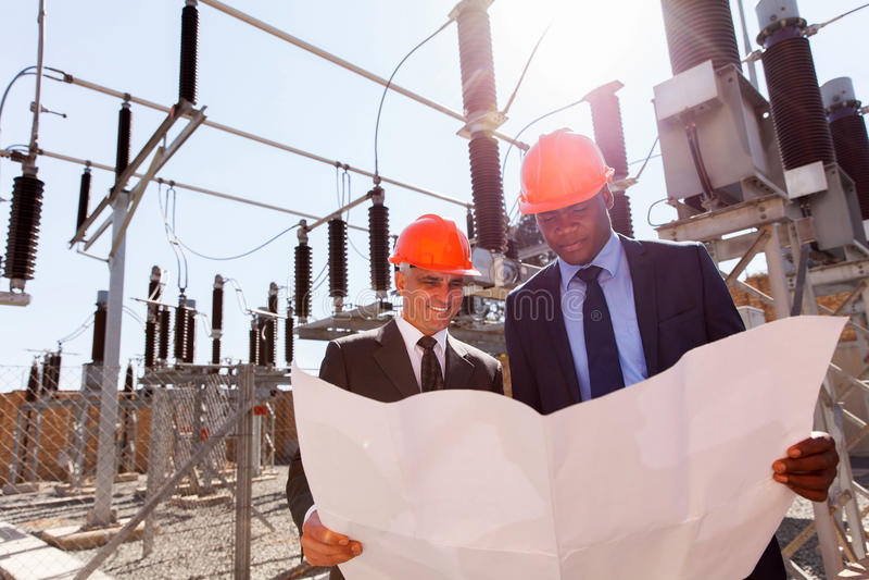 Responsabili di compagnia elettrica immagini stock